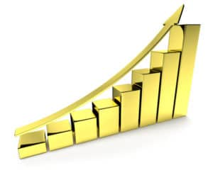Financial growth, investment success and financial business and banking development concept: growing bar chart made of gold with upward golden arrow with reflections isolated, 3d illustration